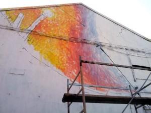 Lavoro sul murale di Blu