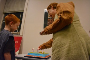 Mithril Turtle founder Michelle Butler lights candles to celebrate the 111st birthday of LOTR character Bilbo Baggins